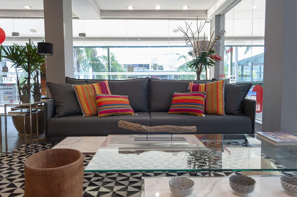 A comfortable gray couch with colorful throw pillows