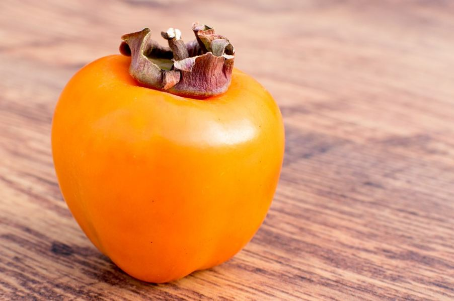 a close up look of a persimmon fruit